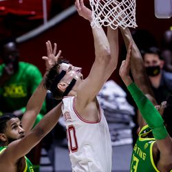Utah Utes forward Mikael Jantunen (20) goes to the hoop during the game against the Oregon Ducks at the Huntsman Center in Salt Lake City on Saturday, Jan. 9, 2021.