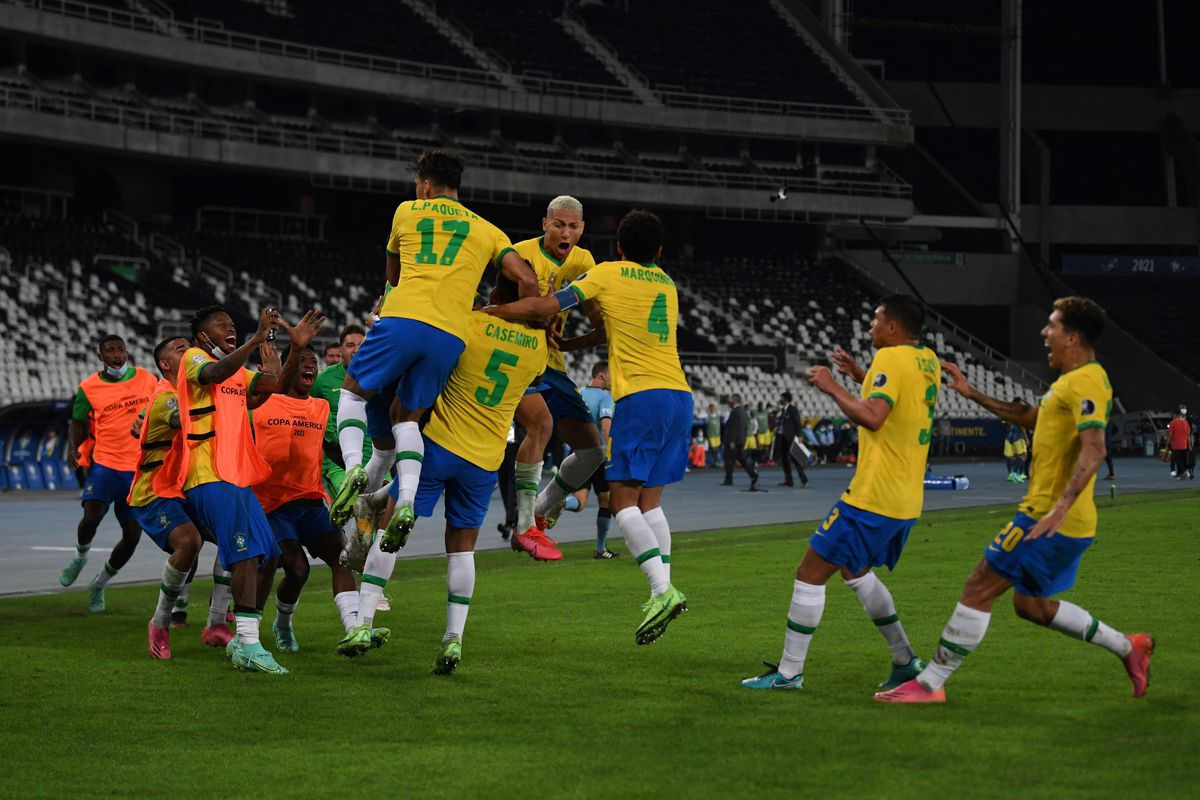 Brazil's players celebrate after scoring against Colombia during the Conmebol Copa America 2021 football tournament group phase match, at the Nilton Santos Stadium in Rio de Janeiro, Brazil, on June 23, 2021.