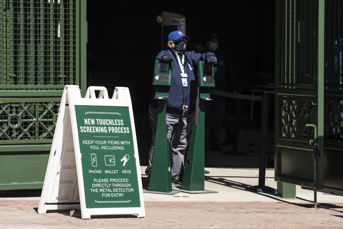 An usher waits for fans to enter Wrigley Field before the Chicago Cubs Opening Day game against the Pittsburgh Pirates.