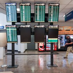 The departures board is barely half-full, even showing some of the next day's departures, in Salt Lake City International Airport's Terminal 1 on Thursday, April 30, 2020. Like airports all over the world, Salt Lake's airport has seen air traffic plummet due to the COVID-19 pandemic.