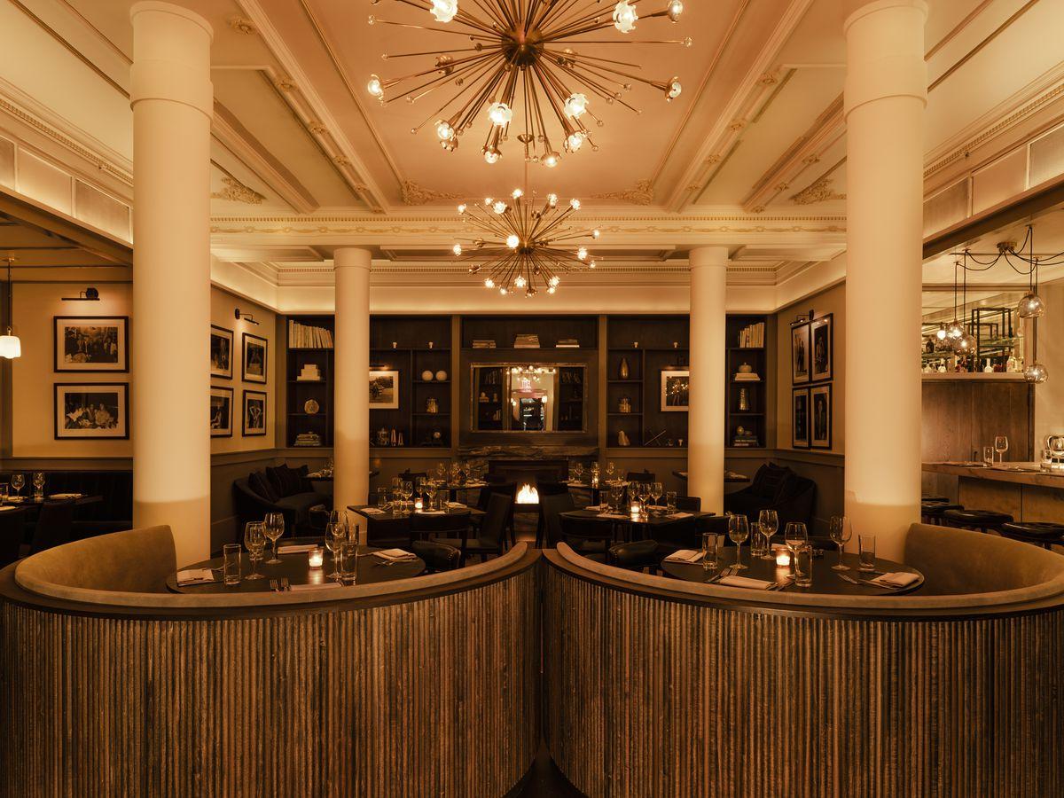 A dark, vintage-looking restaurant interior tinted in brown hues