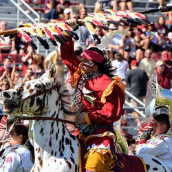 Chief Osceola and Renegade take the field.