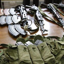 Some of the arms and  ammunition recovered by police  displayed in Nairobi, Kenya, Friday, Sep. 14, 2012. Kenyan police say they have arrested two people suspected to have links with an al-Qaida-linked Somali militant group that was in the last stages of planning a major terrorist attack on Kenya.  Boniface Mwaniki , the head of Kenya's Anti-Terrorism Police Unit, said Friday that police found four suicide vests, a cache of weapons and 12 grenades.