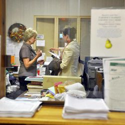 In this Tuesday, Sept. 18, 2012 photo, Republican candidate for U.S. Senate Linda McMahon, left, talks with deputy communications director Kate Duffy during a visit to the Naugatuck Senior Center in Naugatuck, Conn. Wealthy former pro wrestling executive McMahon is shifting her image from groin-kicking CEO to grandmother in her second bid for a Senate seat from Connecticut. Polls show the strategy seems to be working against three-term Democratic congressman Chris Murphy.