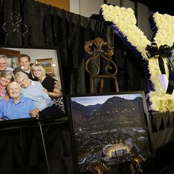 Flowers, photos, drawings and other items are displayed in honor of former BYU football coach LaVell Edwards at a memorial service at the Provo Convention Center on Friday, Jan. 6, 2017.