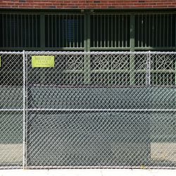 10:53 a.m. Chain link gate fence placed along the curb, just outside of Gate Q, on Sheffield Avenue -