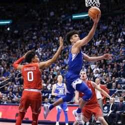 Brigham Young Cougars guard Elijah Bryant (3) makes a layup during the game against the Utah Utes at the Marriott Center in Provo on Saturday, Dec. 16, 2017.