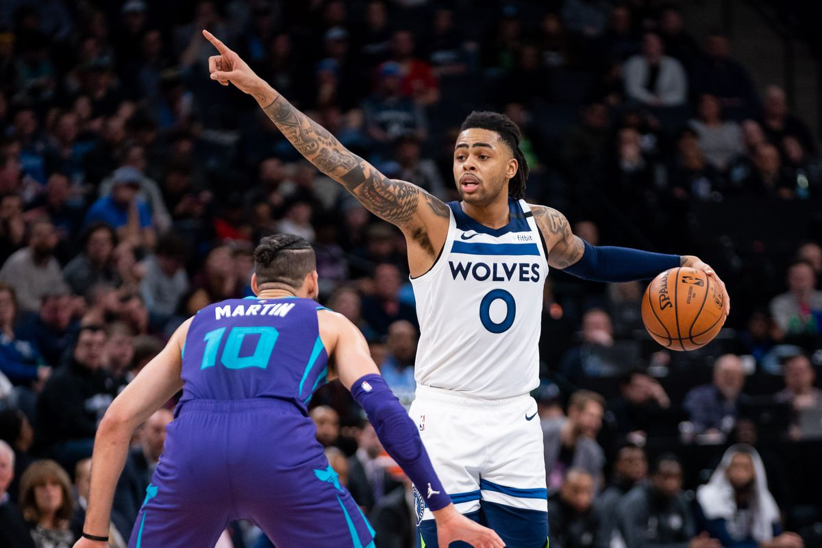 Minnesota Timberwolves guard D'Angelo Russell instructs his team in the fourth quarter against the Charlotte Hornets at Target Center.