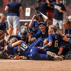 The Enterprise Wolves fall into a pile during the 2A softball championship game against the Beaver Beavers at Spanish Fork Sports Park on Saturday, May 15, 2021. The Wolves won 5-2.