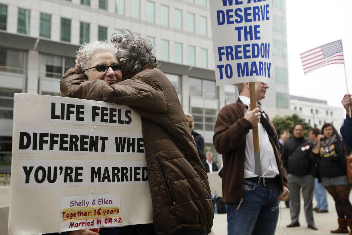 Shelly Bailes, left, hugs her wife Ellen Pontac outside of the Phillip Burton Federal Building in San Francisco, Wednesday, Aug. 4, 2010. A federal judge overturned California's same-sex marriage ban Wednesday in a landmark case that could eventually land