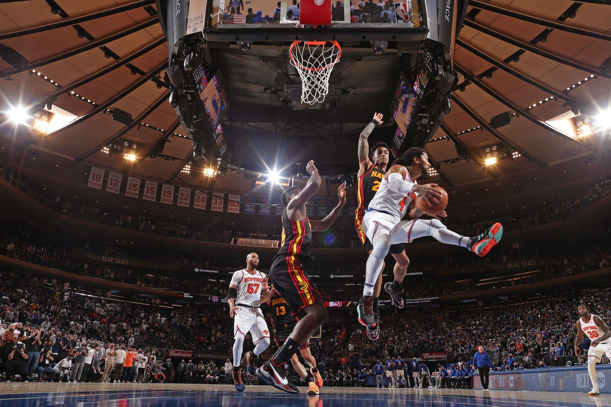 Derrick Rose #4 of the New York Knicks drives to the basket and looks to pass the ball against the Atlanta Hawks during Round 1, Game 1 of the 2021 NBA Playoffs on May 23, 2021 at Madison Square Garden in New York City, New York.