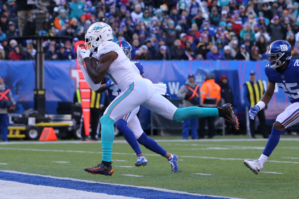 Dolphins wide receiver DeVante Parker catches a touchdown pass against the New York Giants during the second quarter at MetLife Stadium.