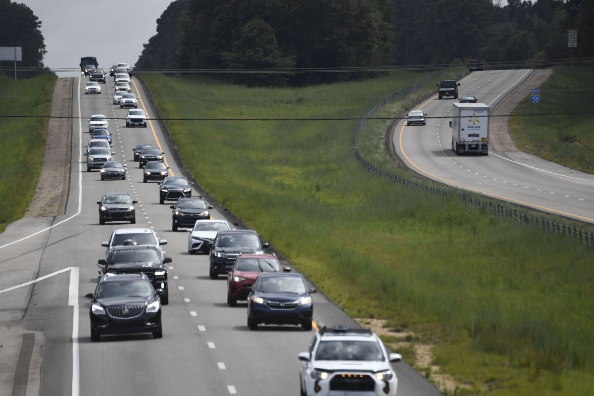 Residents drive on Interstate Highway 55 near Magnolia, Mississippi, as they evacuate away from New Orleans, before the arrival of Hurricane Ida.