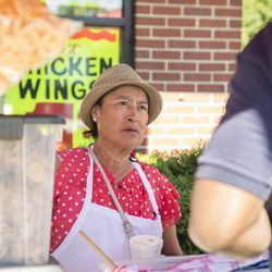 Zenaida Castillo, 60, serves elote in Rogers Park.   Ashlee Rezin/Sun-Times