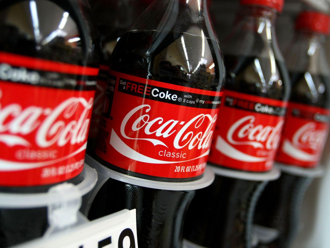 Coke bottles in a store fridge