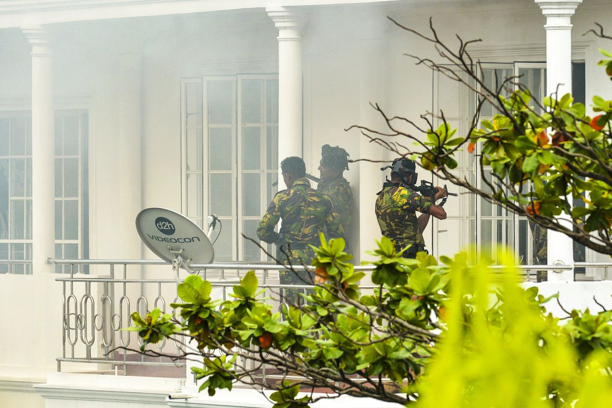 Sri Lankan Special Task Force (STF) personnel are pictured outside a house during a raid in the Orugodawatta area of Colombo.
