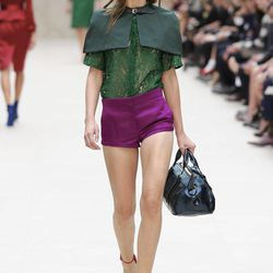 A model displays a design from Burberry Prorsum's Spring/Summer 2013 collection, in Kensington, west London, during London Fashion Week, Monday Sept. 17, 2012.