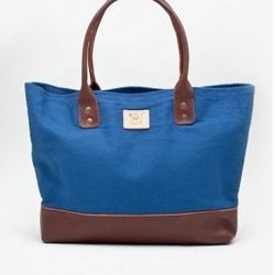 """<a href=""""http://www.kembrel.com/designers-2/will-leather-1/will-leather-utility-tote-blue.html"""">Will Leather Utility Tote</a>, $119 at Kembrel."""