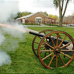 Ray Howser fires a cannon during the 142nd anniversary celebration of Fort Douglas on Saturday.