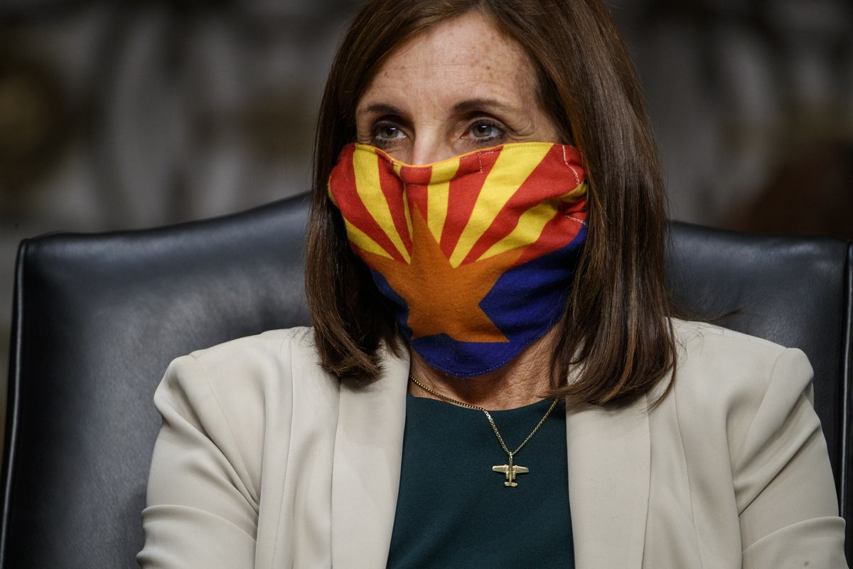 Sen. Martha McSally (R-AZ) wears a mask as she listens to testimony during a Senate Armed Services Committee hearing in May 2020