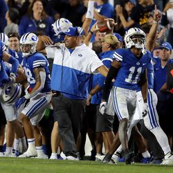 Brigham Young Cougars head coach Kalani Sitake and the rest of the BYU sideline begin to celebrate as they defeat Utah in an NCAA football game at LaVell Edwards Stadium in Provo on Saturday, Sept. 11, 2021. BYU won 26-17, ending a nine-game losing streak to the Utes.