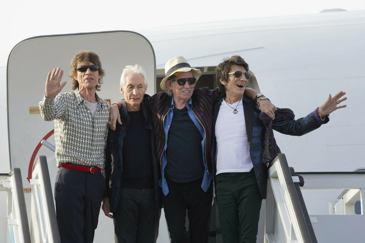 The Rolling Stones — Mick Jagger (from left),  Charlie Watts, Keith Richards and Ron Wood — pose for photos on their plane at Jose Marti International Airport in Havana, Cuba, in 2016.