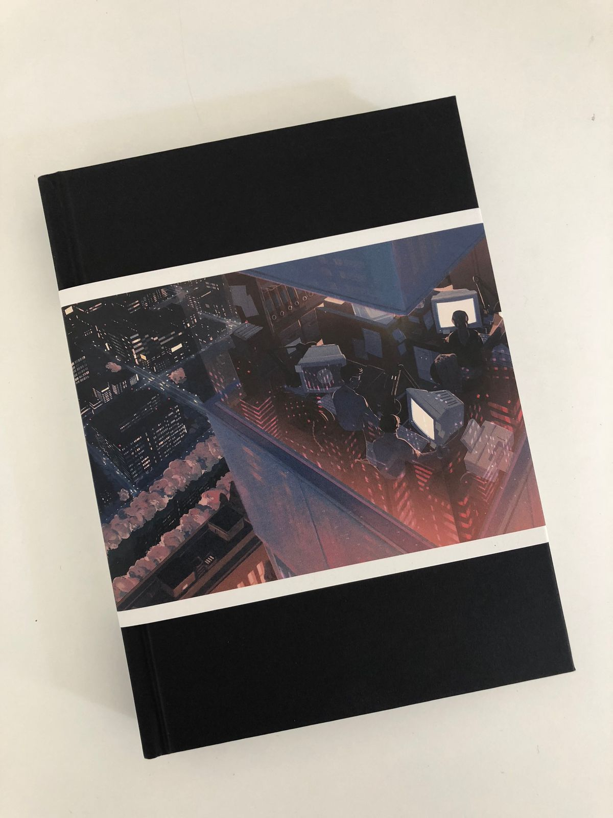 500 Years Later: An Oral History of Final Fantasy VII - photo of book with belly band wrapping