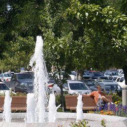 Ryan Raper of Hayden, Idaho, sits near a fountain on the BYU campus last August.
