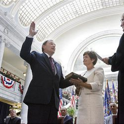 Gary Herbert takes the oath of office from Utah Supreme Court Chief Justice Christine Durham as Herbert's wife, Jeanette, holds a Bible Tuesday  at the Utah State Capitol in Salt Lake City.