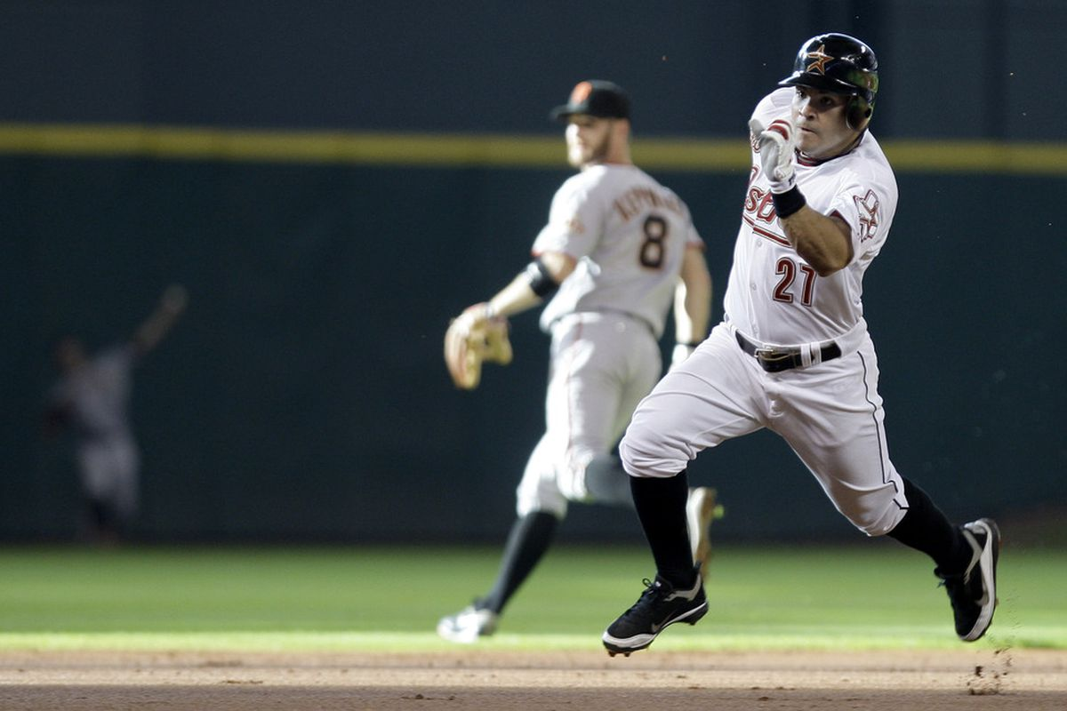 Jose Altuve sprints to third on an inside the park home run in the first inning last night. (Photo by Thomas B. Shea/Getty Images)