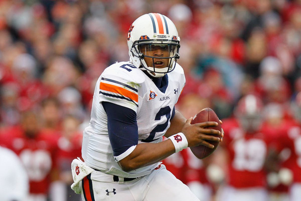 TUSCALOOSA AL - NOVEMBER 26:  Quarterback Cam Newton #2 of the Auburn Tigers rushes out of the pocket against the Alabama Crimson Tide at Bryant-Denny Stadium on November 26 2010 in Tuscaloosa Alabama.  (Photo by Kevin C. Cox/Getty Images)