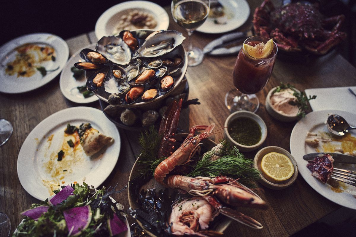 A platter of oysters, seafood, and egg yolk flatbread at Michelin-starred Shoreditch restaurant Brat