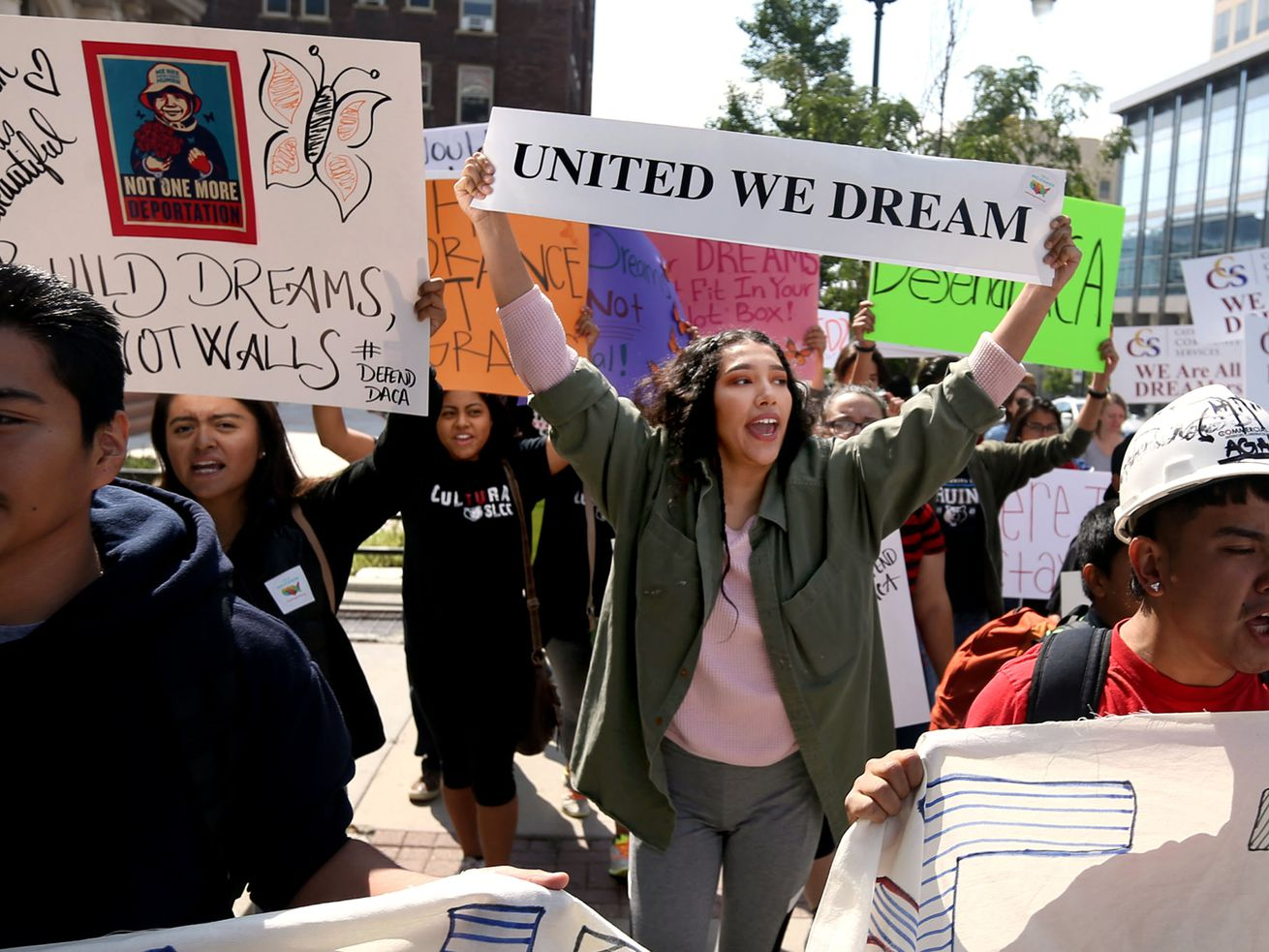 """DACA (Deferred Action for Childhood Arrivals) supporters, including Xochitl Cornejo, center, march to the Capitol during the """"We Are All DREAMers"""" rally in Salt Lake City on Sept. 16, 2017."""