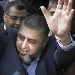 In this April 5, 2012 photo, Egypt's  Muslim Brotherhood candidate for presidency Khairat el-Shater waves to his supporters after he submitted his candidacy papers at the Higher Presidential Elections Commission, in Cairo, Egypt. The presidential election scheduled in May will mark the beginning of a handover of power by the ruling military to an elected civilian, following last year's popular uprising that overthrew Hosni Mubarak. (AP Photo/Amr Nabil)