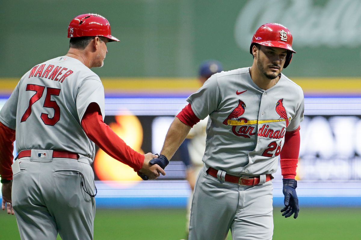 Nolan Arenado of the St. Louis Cardinals is congratulated by Ron 'Pop' Warner after hitting a two run homer in the first inning against the Milwaukee Brewers at American Family Field on September 20, 2021 in Milwaukee, Wisconsin.