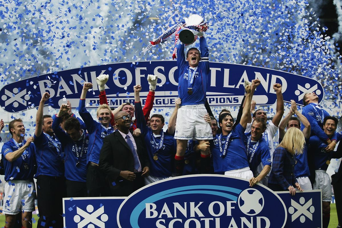 Rangers captain Barry Ferguson lifts the trophy up as he celebrates winning the league with his team-mates