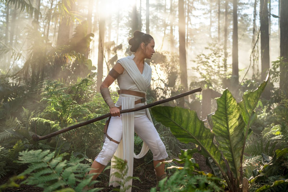 Rey trains in a forest, under the tutelage of General Leia.