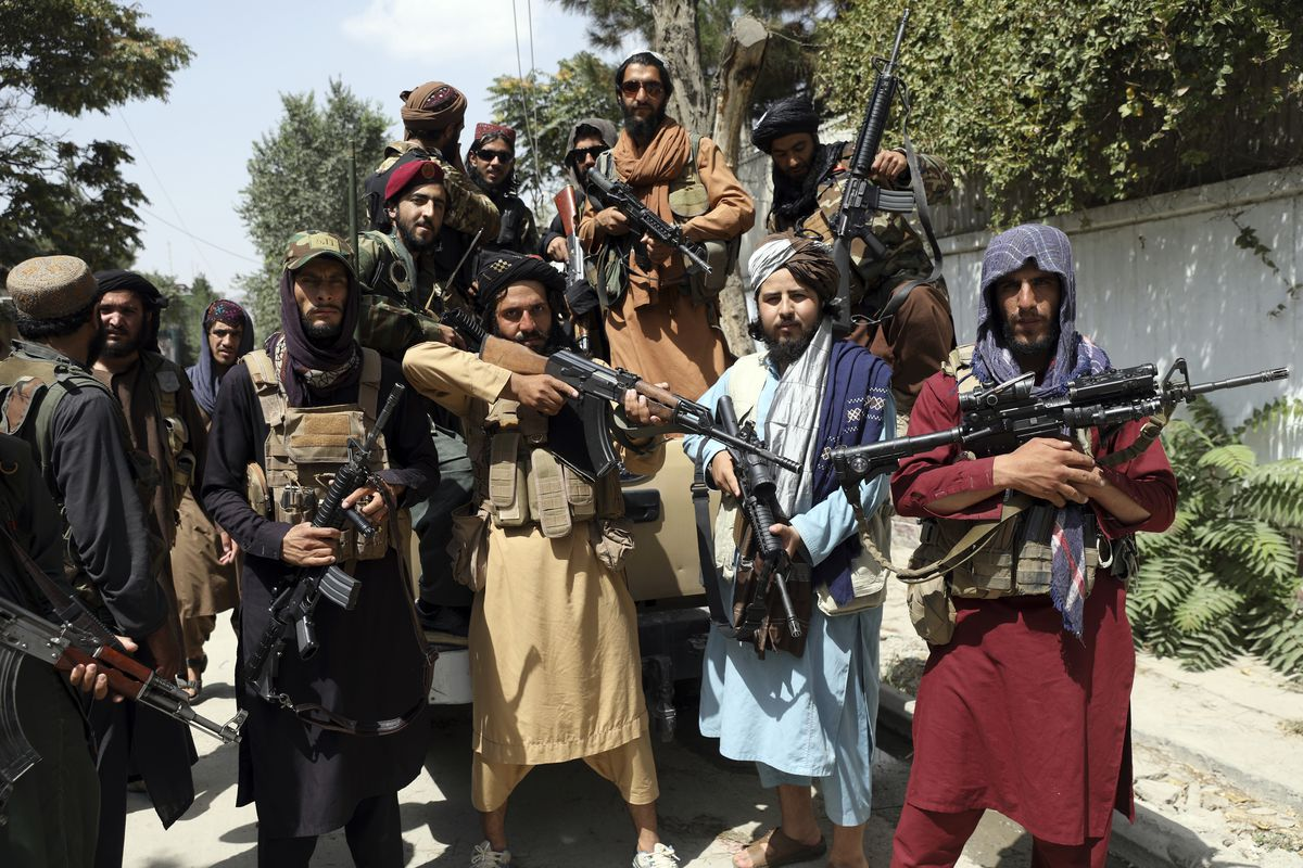 Taliban fighters pose for a photograph in Kabul, Afghanistan, Thursday, Aug. 19, 2021. The Taliban celebrated Afghanistan's Independence Day on Thursday by declaring they beat the United States, but challenges to their rule ranging from running a country severely short on cash and bureaucrats to potentially facing an armed opposition began to emerge.