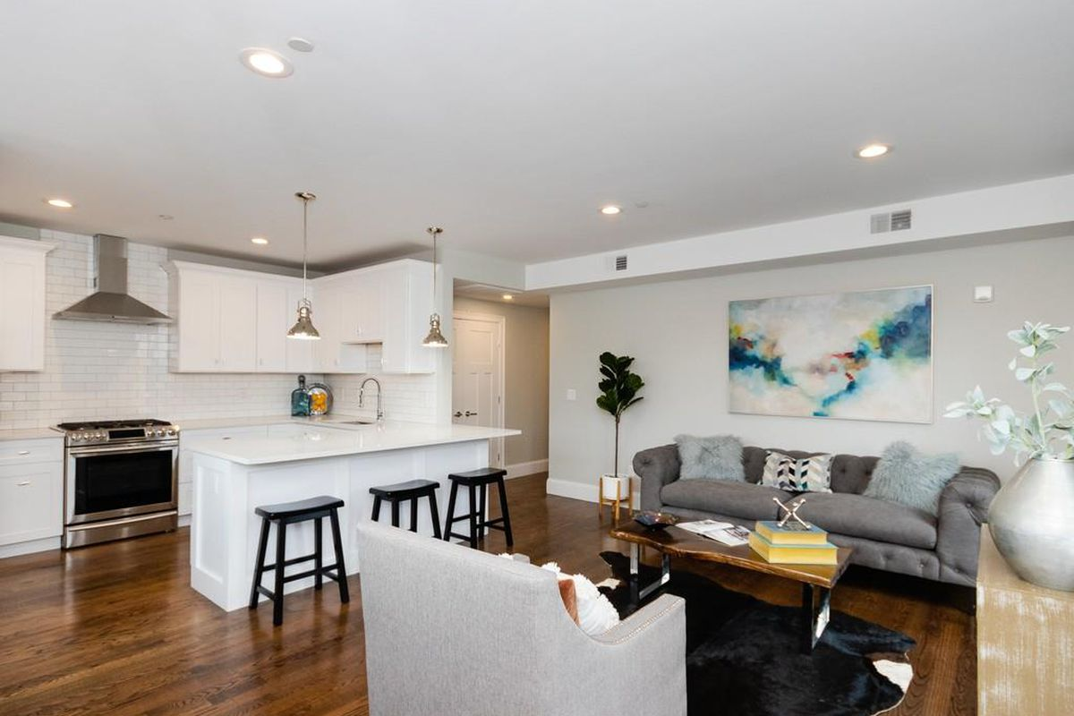 An open living room-kitchen area with furniture.