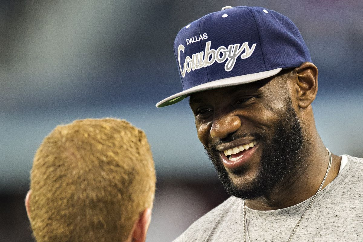 LeBron James is greeted by Head Coach Jason Garrett of the Dallas Cowboys before a game against the New York Giants at AT&T Stadium on September 8, 2013 in Arlington, Texas.