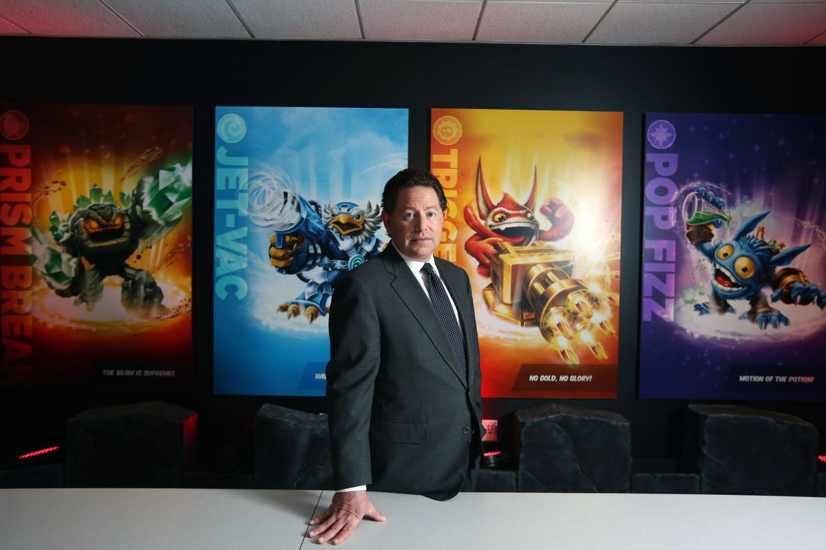 Activision Blizzard CEO Bobby Kotick stands in front of artwork from the Skylanders series