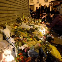People gathered in front of Le Petit Cambodge on the night of November 14