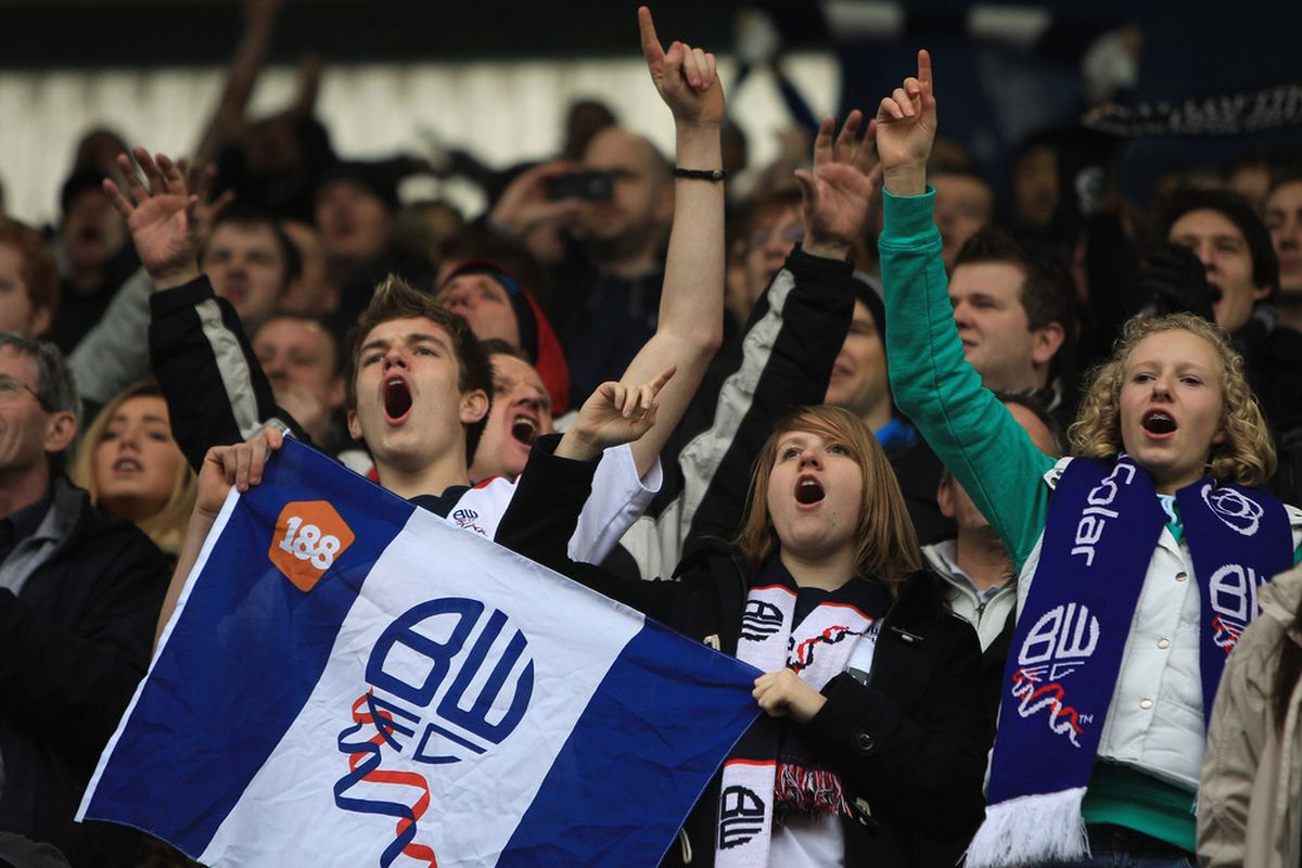 LONDON, ENGLAND - FEBRUARY 18: Bolton fans sing during the FA Cup fifth round match between Millwall and Bolton Wanderers at The Den on February 18, 2012 in London, England.  (Photo by Michael Steele/Getty Images)
