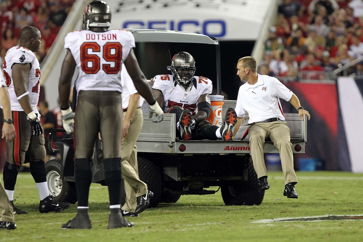 August 24, 2012; Tampa, FL, USA;  Tampa Bay Buccaneers guard Davin Joseph (75) gets carted off the field during the second quarter against the New England Patriots at Raymond James Stadium. Mandatory Credit: Kim Klement-US PRESSWIRE