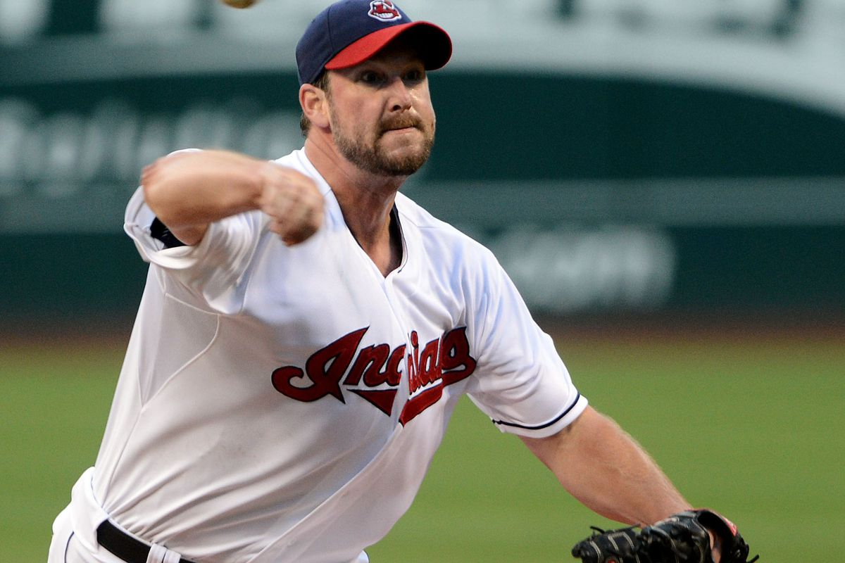 July 20, 2012; Cleveland, OH USA: Cleveland Indians starting pitcher Derek Lowe (26) throws a pitch in the first inning against the Baltimore Orioles during the game at Progressive Field.  Mandatory Credit: Eric P. Mull-USPRESSWIRE