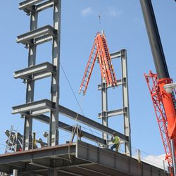 1:48 p.m. Ladders being lifted up to the right-field video board structure -