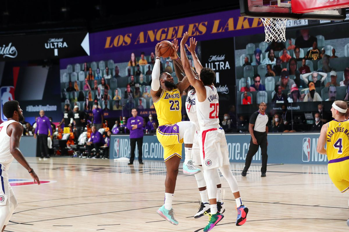 LeBron James of the Los Angeles Lakers drives to the basket during the game against the LA Clippers during a game on July 30, 2020 at The Arena at ESPN Wide World Of Sports Complex in Orlando, Florida.