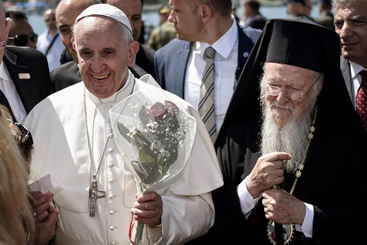 Pope Francis, left, is escorted by Ecumenical Patriarch Bartholomew I, during a visit to the Greek island of Lesbos on April 16, 2016.