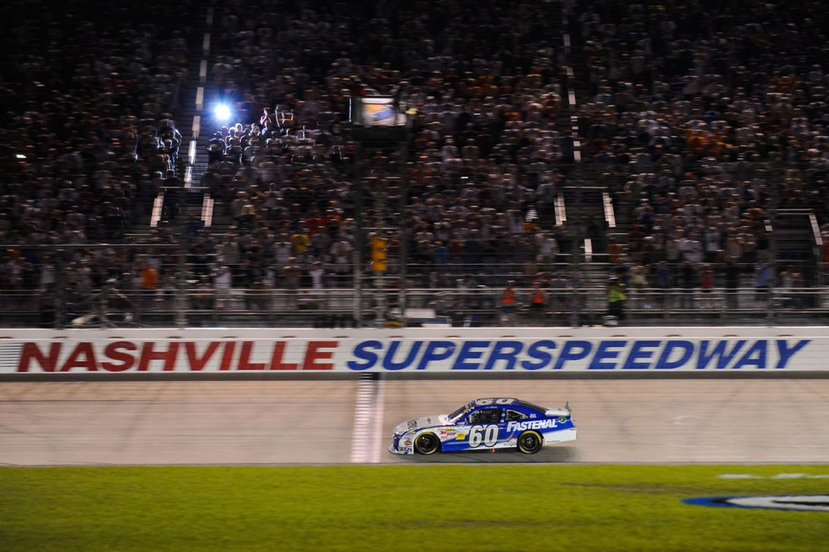 Carl Edwards takes the checkered flag. (Photo: Jason Smith/Getty Images for NASCAR)