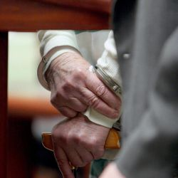 Evelyn Christine Johnson, 75, leans on her cane as she is sentenced Thursday, Feb. 9, 2012, to one to 15 years in prison for fatally shooting her husband, Alan Lavoy Johnson, in August 2004. She was initially charged with murder, a first-degree felony, but pleaded guilty in December 2011 to manslaughter, a second-degree felony.